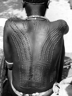 Scarification on the back of this female member of the Fali tribe, in the Mandara Mountains, has been done to enhance her beauty. But scarification on the face was done to ensure that if a person were captured, his or her tribal origin would be clearly identifiable. - funny enough this is my ethnic group