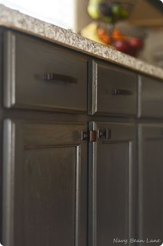 Grey kitchen cabinets would match the new appliances...