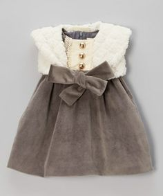 This flutter-sleeved frock will have girls looking like little angels. A lace-trimmed panel with decorative buttons adds a dash of darling, while a matching bolero is perfect for slipping on when the weather gets chilly.