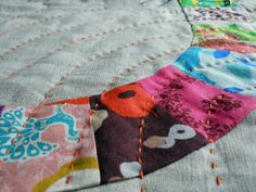 Quilt with Colorful Patterning and Hand Stitching