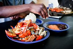 Banku, grilled lobsters and clams with pepper