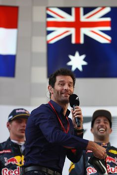 Mark Webber Photos Photos - Mark Webber throws the shoe of Daniel Ricciardo of Australia and Red Bull Racing out into the crowd from the podium during the Malaysia Formula One Grand Prix at Sepang Circuit on October 2, 2016 in Kuala Lumpur, Malaysia. - F1 Grand Prix of Malaysia