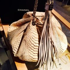 Chanel Tan Python handbag/evening bag Amazing super soft Chanel Tan Python handbag, tan silky satin interior. Paid 9k!!!!!!Silver metal accents. Like new inside and out. Comes with box, duster, birth certificate, booklet and smile. Paid 9k, no trades and no low ball offers I will not respond. Have a beautiful Chanel day!!! :-) CHANEL Bags