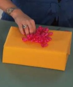 A present without a bow is like a cake without icing: It's missing the finishing touch. This video shows an easy, step-by-step method for making the most dramatic gift-topper of all―a curly ribbon bow. Try doing one the next time you gift wrap.