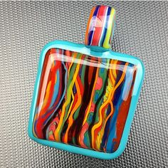 Coogi over orange crush with agua azul border on this double-sided Coogi Textile pendant (Swipe to see the other side). This is one of the latest Textiles in my Coogi series and it's now available through @legacyglassworks.  They will ship so hit them up to scoop it!  #tripleaglass #legacyglass #mnglass #mnglassenthusiasts #glassofig #coogi #coogisweater #pendant #higherfashion #smokeinstyle #textile
