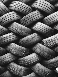 Tires are arranged in a fashion that make it look like they are knitted together creating a perfect sense of harmony. Its also a good example of the consistency of how they are arranged and create a pattern.