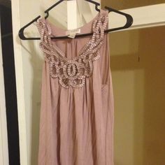 Light Lavendar Kenar Sleeveless Top Beading is intact. Just a little wrinkly from hanging in my closet. Very pretty! Kenar Tops Tank Tops