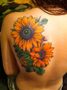 Would never get this big of a tattoo, but I am in awe of this. Sunflowers are amazing.