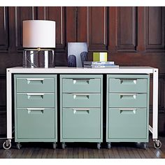Console table with filing cabinets on wheels for storage - painted filing cabinets, good color