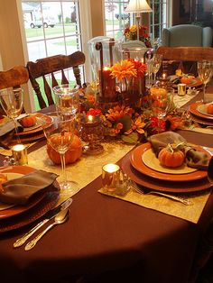 Love the bright Fall colors of burnt orange, gold, cream, and brown.......brings back memories of the Thanksgiving table.