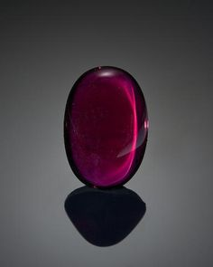 Rhodolite Garnet Cabochon - Weighing approximately 67.99 carats and measuring 28.0 x 19.0 x 13.0mm