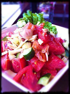 Our Spring smoked salmon salad w/ lush tomatoes, zucchini, red onion & shredded mozzarella cheese