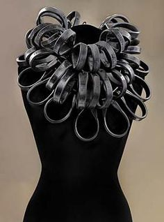 Flower  1999  Lonna Keller  Born: Lincoln, Nebraska 1972  sterling silver and rubber  3 strands, each: 19 1/2 x 26 x 16 in. (49.5 x 66 x 40.6 cm)  Smithsonian American Art Museum  Museum purchase through the Richard T. Evans Fund  1999.56A-C