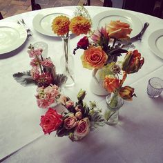Orange dahlias, parrot tulips, roses, pink roses, stock, lisianthus, dusty miller
