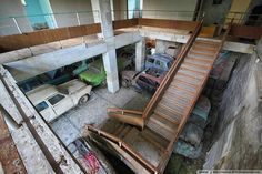 Abandoned Summer Camp, Moscow region, Russia filled with old abandoned vehicles.