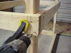Driving screws in frame of workbench.