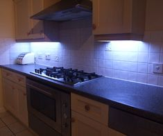 In this instructable, I will describe my project to replace my under the cabinet kitchen lights with LEDs. I couldn't resist adding a microcontroller...