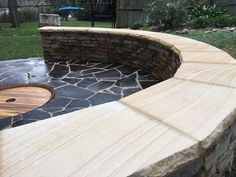 Sandstone seating area with bluestone crazy paving