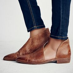 Half boot, half sandals, this pair of leather flats are a must-own.