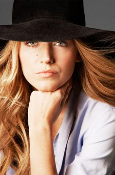 Blake Lively wears a wide-brimmed black hat and blue shirt for ELLE, April 2014, photographed by Cedrick Buchet