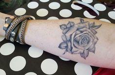 Black tattoo rose.