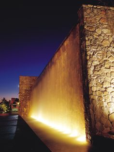 Exterior water feature lineal light on wall