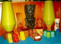 Tiki mugs, beehive lamps, and tiki wood scupltures