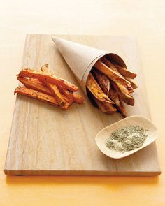 Baked Sweet-Potato Fries - Martha Stewart Recipes. This is some kind of sorcery, because these were the best sweet potato fries I've ever had.