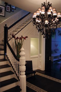 stairs painted risers, shaded chandelier black and white greek key