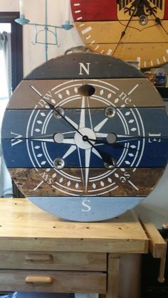 This 32 inch clock is stained and painted in chalk paint. The Spool Clock was sanded to achieve a rustic look. We finished it by applying a coat of wax. The clock movement is a high torque mechanism to handle the larger clock hands. The mechanism operates with AA batteries. The hardware and wire for Large Wooden Spools, Wooden Spool Tables, Wooden Cable Spools, Wood Spool, Diy Cable Spool Table, Cable Reel Table, Cable Spool Ideas, Shabby Chic Wall Clock, Outdoor Wall Clocks