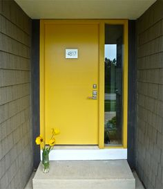 "Adore this yellow door - look closely at the sidelight window.  There's a little frosted ""Hello."""