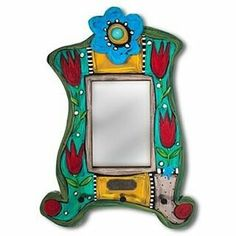 My friend Elisa is the fabulous artist behind E. Drumm Designs. Elisa designed all sorts of amazing pieces. I love her colorful and whimsical mirrors #mirrors #indieme_acre #handpainted #artsy #colorful #handmade #craftsposure #foundmademodern #makersmovement #wholesalecrafts #woodworking #original #colorful #hfccoop #fun #homedecor #homeaccents