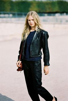 German model Anna Ewers, Tuileries: leather jacket + sweater + pants: fall outfit