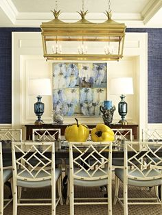Diving dining room! White chippendale chairs, pineapple lantern, lapis blue grasscloth. Taylor & Taylor