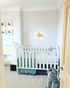 The children's shared bedroom is finished! It is part nursery for baby boy and part bedroom for my little girl so gender neutral was important but I also wanted to highlight the beautiful period features of this room such as the cornice, ceiling rose and cast iron fireplace. The lightest blue (dulux cornflower white) keeps it bright, light and calming. One of my favourite elements is the cloud silhouette wall lights.