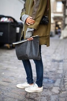 Small details like gray sleeves peeking out from a coat's sleeve give outfits that extra something. Plus, an oversized pouch makes a great day bag.