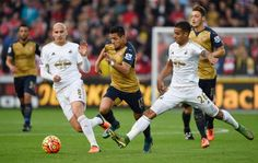 Jonjo Shelvey and Kyle Naughton in action with Alexis Sanchez