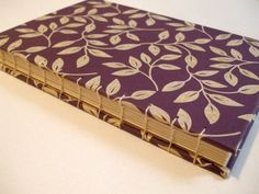 purple cover + ivory binding and thread