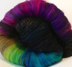 This addition to the bird batts was an installment in my batt club - called COMMON GRACKLE. The Common Grackle isnt exactly a nice bird, but he/she does have beautiful jeweled tones over their black feathers. This batt gives you the best of both - the jewel coloring and elegance and the niceness:) Super soft superwash merino with pre-trimmed sari silk and a good amount of sparkle will make these jeweled feathers shine.