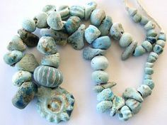 Ancient faience beads that were found during excavations in Afghanistan | Date…