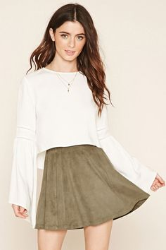 Style Deals - This skater skirt is crafted from faux suede and is complete with an elasticized waist.
