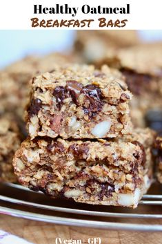An Easy Healthy Oatmeal Breakfast Bars Recipe Made with dates peanut butter and apple sauce chocolate chips coconut rolled oats nuts and seeds optional dried fruit cranbe. Oatmeal Breakfast Bars Healthy, Vegan Oatmeal, Healthy Bars, Peanut Butter Oatmeal, Breakfast Cookies, Vegan Protein Bars, Vegan On The Go Breakfast, Healthy Oat Recipes, Baked Oatmeal Bars