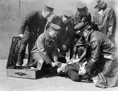 Members of the New York Fire Department attend to a fire victim.	 (Courtesy NYC Municipal Archives)