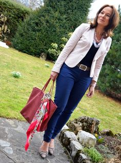 Tie a scarf on your bag for a pop of color with any outfit!