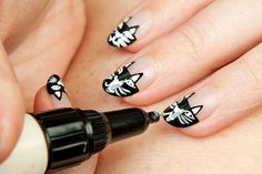 Charlotte Olympia Cat Nails by ebmonson, via Flickr