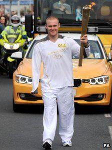 Mark Ormrod carrying the Olympic Flame through his hometown in Plymouth 20.05.12