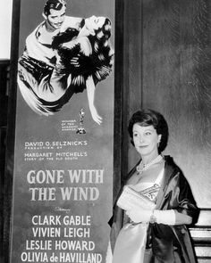 Vivien Leigh posing by a poster of Gone With the Wind on the occasion of its reissue commemorating the centennial of the Civil War. The Best Films, Great Movies, Classic Hollywood, Old Hollywood, Hollywood Glamour, Victor Fleming, Leslie Howard, Margaret Mitchell, Tomorrow Is Another Day