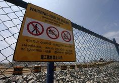 A warning sign is seen near seafront construction site of Chinese real estate project of a port city in Colombo