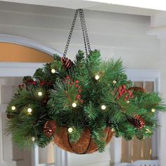 DIY - Buy a hanging basket add a few springs of garland, some battery operated lights, pine cones and holly for this wonderful porch decoration.