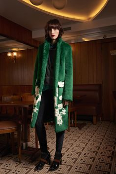 Sonia by Sonia Rykiel - Fall 2015 Ready-to-Wear - Green fuzzy coat with white floral graphics  near bottom.